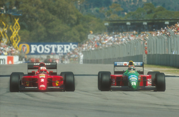 1990 Australian Grand Prix.Adelaide, Australia.2-4 November 1990.Nelson Piquet (Benetton B190 Ford) overtakes Nigel Mansell (Ferrari 641) for 2nd place. They finished in 1st and 2nd positions respectively.Ref-90 AUS 11.World Copyright - LAT Photographic