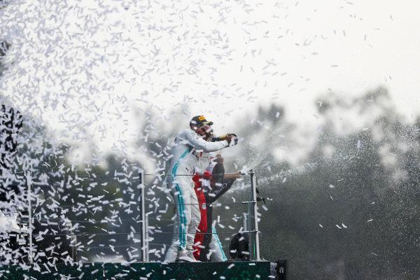 Race winner Lewis Hamilton, Mercedes AMG F1 and Sebastian Vettel, Ferrari celebrate on the podium with the champagne