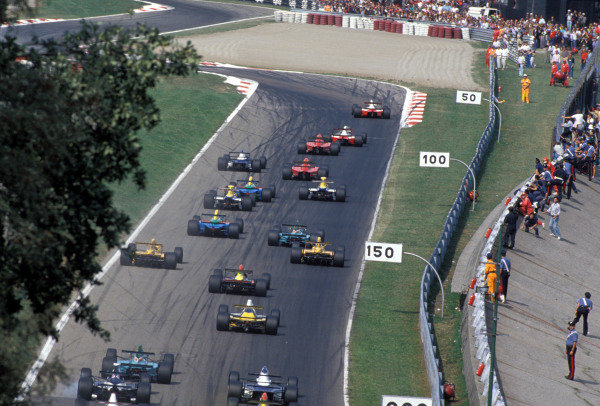 The cars stream away at the start of the race.