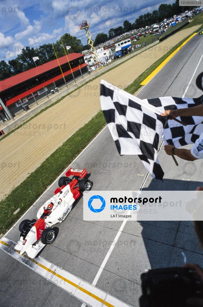Hélio Castroneves, Team Penske, Reynard 2KI Honda, celebrates as he crosses the finish line and takes the chequered flag.