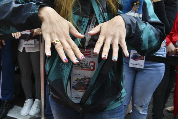 A fan with Lewis Hamilton Mercedes AMG F1 painted nails