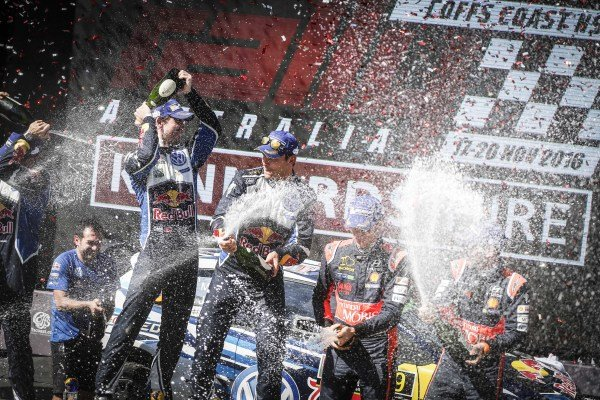 Rally winners Andreas Mikkelsen (NOR) / Anders Jaeger Synnevag (NOR), Volkswagen Motorsport II WRC and third placed Thierry Neuville (BEL) / Nicolas Gilsoul (BEL), Hyundai Motorsport N WRC celebrate on the podium with the champagne at FIA World Rally Championship, Rd13, Rally Australia, Day Three, Coffs Harbour, New South Wales, Australia, 20 November 2016.