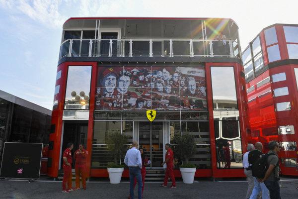 Ferrari motorhome in the paddock with 90 Years branding