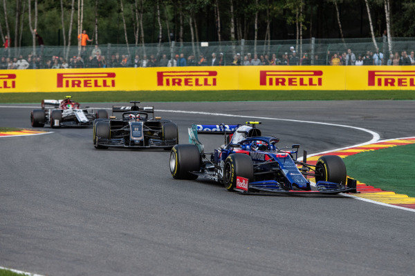 Pierre Gasly, Toro Rosso STR14, leads Romain Grosjean, Haas VF-19, and Antonio Giovinazzi, Alfa Romeo Racing C38