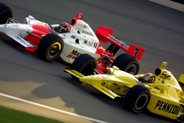 2003 IRL Test in the West.California Speedway, Fontana, California, USA.3-4 February 2003. Helio Castroneves (Team Penske) races with Sam Hornish Jr. (Panther Racing) during testing.World Copyright - Phillip Abbott/LAT Photographic