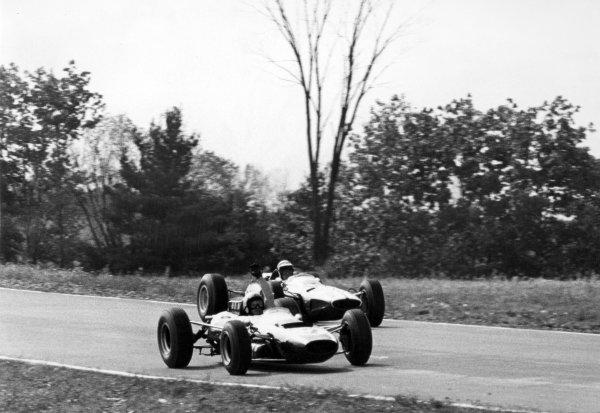 1965 United States Grand Prix.Watkins Glen, New York, USA. 1st-3rd October 1965.Bruce McLaren, Cooper T77, retires as Pedro Rodriguez, Ferrari 1512, 5th position, passes, action.World Copyright - LAT Photographic.Ref-B/W Print.