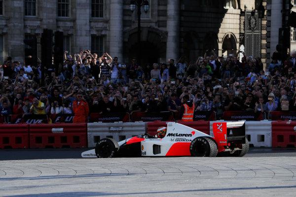 London, United Kingdom.  Wednesday 12 July 2017. Stoffel Vandoorne, McLaren, demonstrates a 1991 McLaren MP4/6 that was raced by Ayrton Senna. World Copyright: Zak Mauger/LAT Images  ref: Digital Image _54I2239