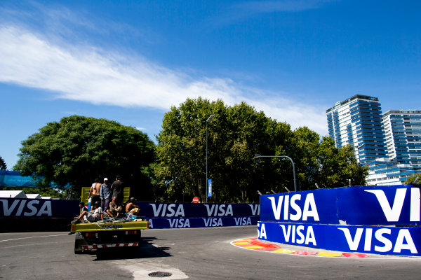 2015/2016 FIA Formula E Championship. Buenos Aires ePrix, Buenos Aires, Argentina. Friday 5 February 2016. Track workers on the back of a truck. Photo: Zak Mauger/LAT/Formula E ref: Digital Image _L0U9746