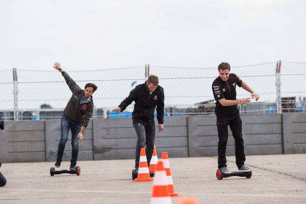2014/2015 FIA Formula E Championship. Berlin ePrix, Berlin Tempelhof Airport, Germany. Thursday 21 May 2015 Scott Speed (USA)/Andretti Autosport - Spark-Renault SRT_01E, Nelson Piquet Jr (BRA)/China Racing - Spark-Renault SRT_01E and Jerome D'Ambrosio (BEL)/Dragon Racing - Spark-Renault SRT_01E on hovertrax. Photo: Andrew Ferraro/LAT/Formula E ref: Digital Image _FER0892