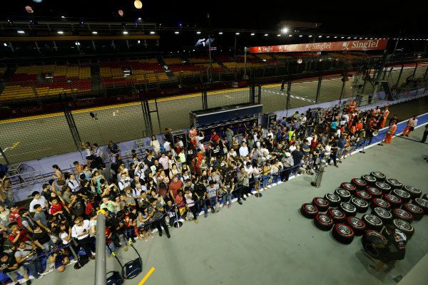 Marina Bay Circuit, Singapore. 19th September 2013. Fans in the pitlane. World Copyright: Alastair Staley/LAT Photographic. ref: Digital Image _R6T9674