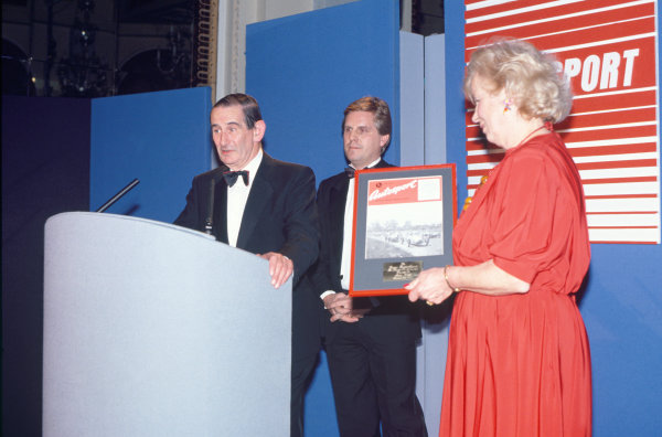1989 Autosport Awards. Cafe Royal, London, England. 4th January 1990. John Webb receives the first ever Gregor Grant Award from Mrs Grant, portrait.  World Copyright: LAT Photographic. Ref: Colour Transparency.
