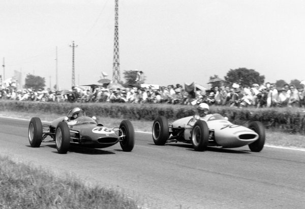 1961 French Grand Prix Reims, France. 30 June-2 July 1961 Willy Mairesse (#48 Lotus 21-Climax) and Henry Taylor (#30 Lotus 18/21-Climax).World Copyright: LAT PhotographicRef: Autosport b&w print