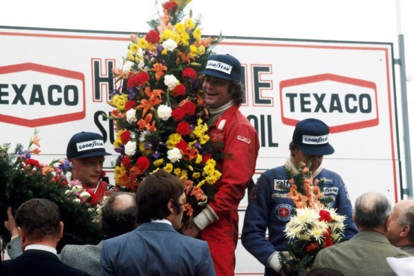 The podium (L to R): Niki Lauda (AUT) Ferrari, second; Gunnar Nilsson (SWE) Lotus, celebrating his first and only GP victory; Ronnie Peterson (SWE) Tyrrell, third. Belgian Grand Prix, Rd 7, Zolder, Belgium, 5 June 1977.BEST IMAGE