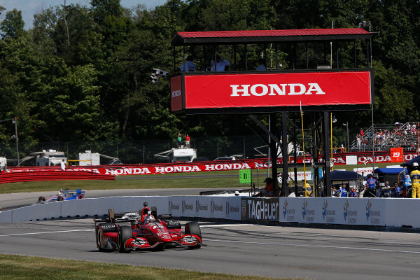31 July - 2 August, 2015, Lexington, Ohio, USA Winner Graham Rahal pumps his fist in the air as he takes the checkered flag and win © 2015, Michael L. Levitt LAT Photo USA