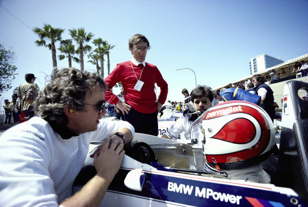 Nelson Piquet, Brabham BT52B BMW, with Charlie Whiting, Bernie Ecclestone and Gordon Murray in the pits.
