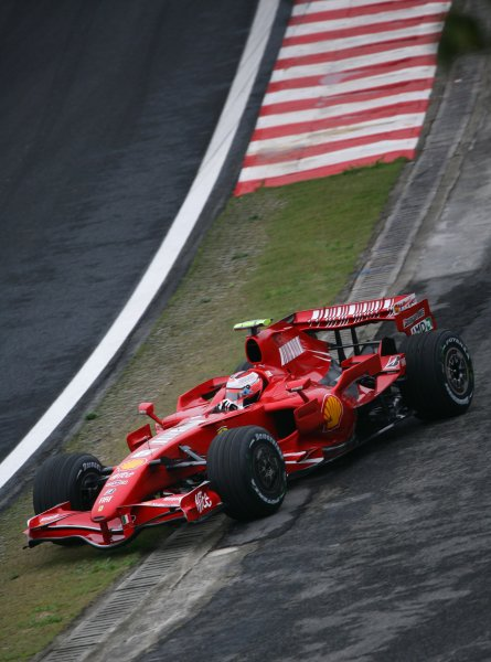 2007 Brazilian Grand Prix - Friday Practice Interlagos, Sao Paulo, Brazil 19th October 2007. Kimi Raikkonen, Ferrari F2007, runs wide. Action.  World Copyright: Steve Etherington/LAT Photographic ref: Digital Image WI2T8086
