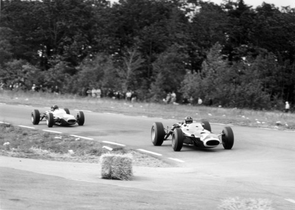 1965 United States Grand Prix. Watkins Glen, New York, USA. 1-3 October 1965. Graham Hill, BRM P261, 1st position, leads Dan Gurney, Brabham BT11, 2nd position, action. World Copyright - LAT Photographic. Ref- B/W Print.