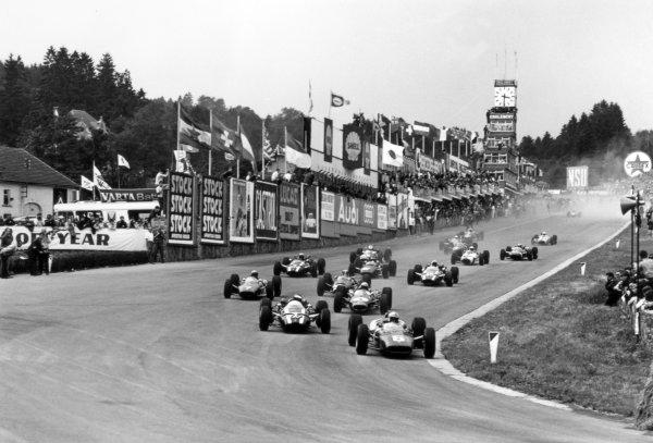1966 Belgian Grand Prix.Spa-Francorchamps, Belgium. 12 June 1966.John Surtees, Ferrari 312, 1st position, leads Jochen Rindt, Cooper T81-Maserati, 2nd position, Jack Brabham, Brabham BT19-Repco, 4th position, Lorenzo Bandini, Ferrari 158/246, 3rd position, Jackie Stewart, BRM P261, retired, Richie Ginther, Cooper T81-Maserati, 5th position, Mike Spence, Lotus 33-BRM, retired, and Jo Bonnier, Cooper T81-Maserati, retired, at the start, action.World Copyright: LAT PhotographicRef: 34879