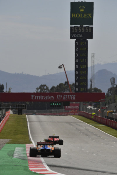 Charles Leclerc, Ferrari SF90, leads Lando Norris, McLaren MCL34