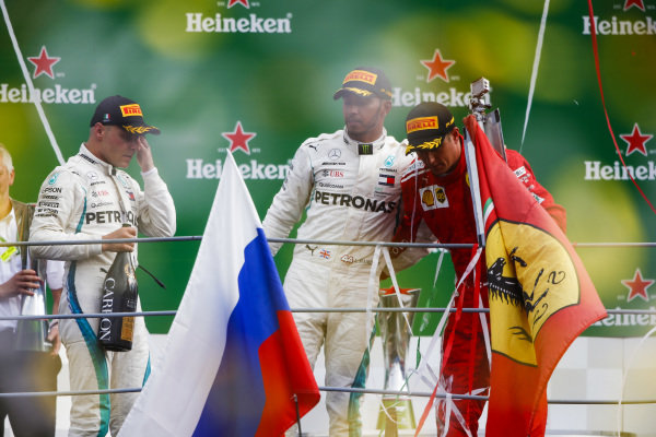 Valtteri Bottas, Mercedes AMG F1, 3rd position, Lewis Hamilton, Mercedes AMG F1, 1st position, and Kimi Raikkonen, Ferrari, 2nd position, celebrate on the podium.
