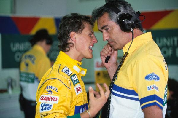 Spa-Francochamps, Belgium.28-30 August 1992.Michael Schumacher (Benetton Ford) talks with team boss Flavio Briatore, portrait.World Copyright - LAT Photographic