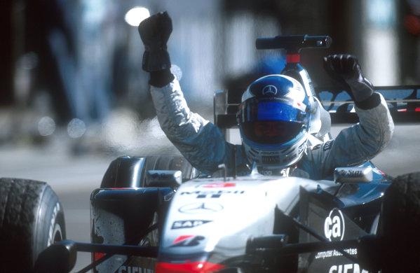 2001 United States Grand Prix. Indianapolis, Indiana, USA. 28-30 September 2001. Mika Hakkinen (McLaren MP4/16 Mercedes) celebrates his 1st position in parc ferme. Ref-01 USA 18. World Copyright - LAT Photographic