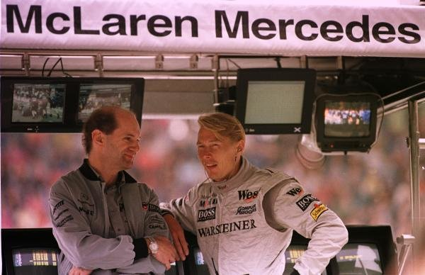 1998 Italian Grand Prix.Monza, Italy.11-13 September 1998.McLaren Mercedes-Benz technical director Adrian Newey talks to Mika Hakkinen on the pit wall.World Copyright - LAT Photographic