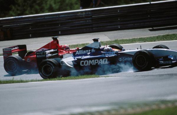 Juan Pablo Montoya, Williams FW23 BMW, locks up as he battles with Michael Schumacher, Ferrari F2001.