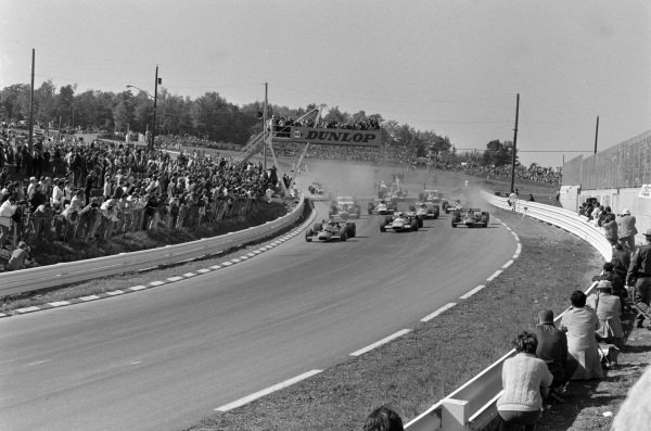 Jochen Rindt, Lotus 49B Ford, leads Jackie Stewart, Matra MS80 Ford, and Graham Hill, Lotus 49B Ford, at the start.