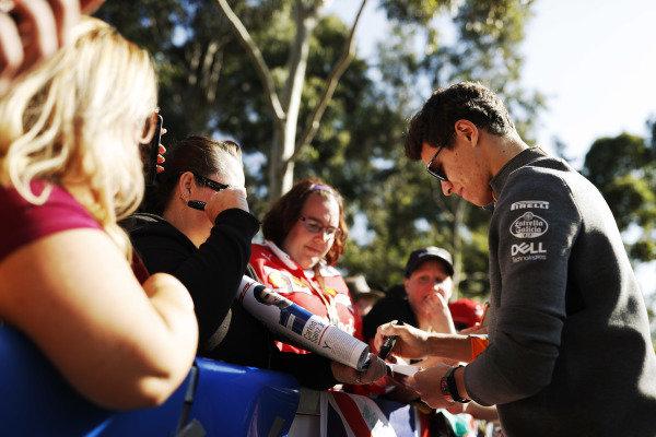 Lando Norris, McLaren, signs an autograph