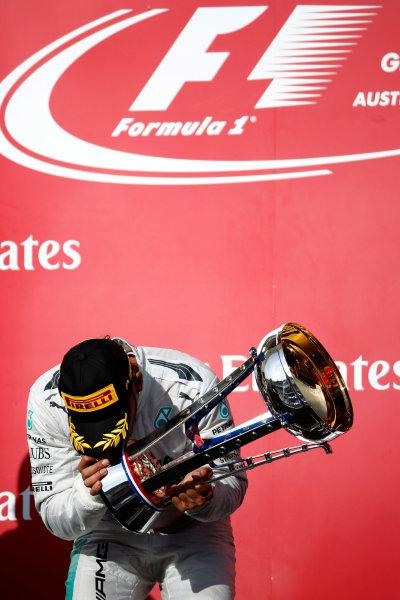 Circuit of the Americas, Austin, Texas, United States of America. Sunday 2 November 2014. Lewis Hamilton, Mercedes AMG, 1st Position, with his trophy on the podium. World Copyright: Glenn Dunbar/LAT Photographic. ref: Digital Image _W2Q8604