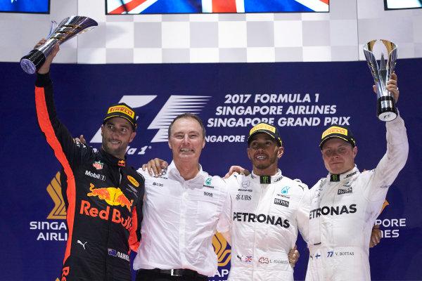 Marina Bay Circuit, Marina Bay, Singapore. Sunday 17 September 2017. Daniel Ricciardo, Red Bull Racing, 2nd Position, Lewis Hamilton, Mercedes AMG, 1st Position, and Valtteri Bottas, Mercedes AMG, 3rd Position, on the podium. World Copyright: Steve Etherington/LAT Images  ref: Digital Image SNE17355