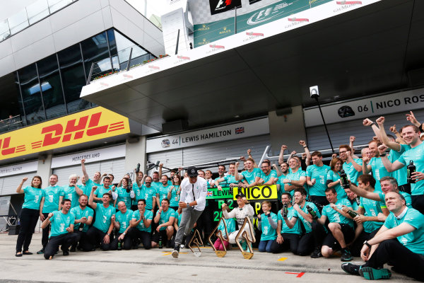 Red Bull Ring, Spielberg, Austria. Sunday 21 June 2015. Nico Rosberg, Mercedes AMG, 1st Position, and Lewis Hamilton, Mercedes AMG, 2nd Position, celebrate with their team. World Copyright: Alastair Staley/LAT Photographic. ref: Digital Image _R6T7248