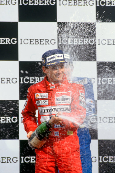 Phoenix, Arizona, USA.9-11 March 1990.Ayrton Senna (McLaren Honda) celebrates 1st position with his champagne on the podium.Ref-90 USA 05.World Copyright - LAT Photographic