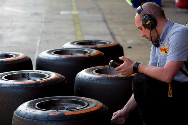 Circuit de Barcelona Catalunya, Barcelona, Spain. Wednesday 15 March 2017. A pirelli engineer checking tyre temperatures.  Photo: Alastair Staley/FIA Formula 2 ref: Digital Image 585A0181