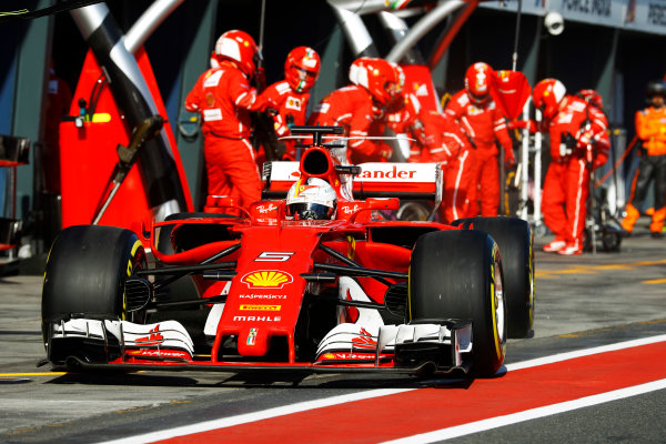 Albert Park, Melbourne, Australia. Sunday 26 March 2017. Sebastian Vettel, Ferrari SF70H, makes a pit stop. World Copyright: Steven Tee/LAT Images ref: Digital Image _R3I0751