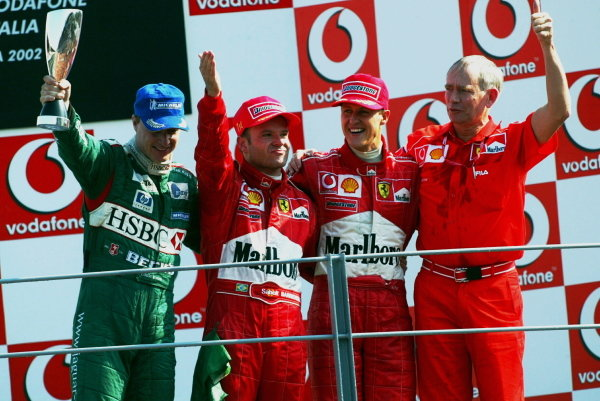 The podium (L to R): Eddie Irvine (GBR) Jaguar third; Rubens Barrichello (BRA) Ferrari winner; Michael Schumacher (GER) Ferrari second; Rory Byrne (RSA) Ferrari Chief Designer.