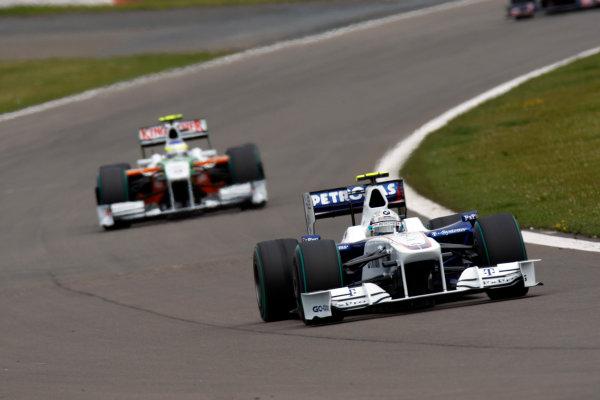 Nurburgring, Germany12th July 2009Nick Heidfeld, BMW Sauber F1 09, 10th position, leads Giancarlo Fisichella, Force India VJM02 Mercedes, 11th position. Action. World Copyright: Glenn Dunbar/LAT Photographicref: Digital Image _3GD6668
