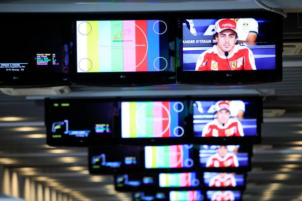 Autodromo Nazionale di Monza, Monza, Italy.9th September 2010.Fernando Alonso, Ferrari F10 on the screens in the Media Centre.World Copyright: Andrew Ferraro/LAT Photographicref: Digital Image AF5D6262