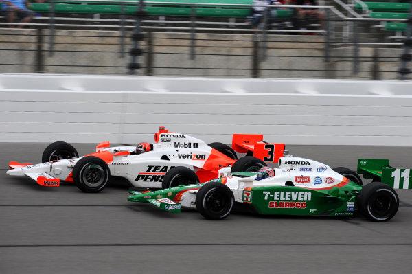 L-R: Helio Castroneves (BRA) Team Penske, and Tony Kanaan (BRA) Andretti Green Racing.IndyCar Series, Rd3, Road Runner Turbo 300, Kansas Speedway, Kansas, USA. 25-26 April 2009.