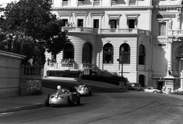 Monte Carlo, Monaco. 22nd May 1955. Juan Manuel Fangio (Mercedes-Benz W196) retired, leads Stirling Moss (Mercedes-Benz W196) 9th position, action. World Copyright: LAT Photographic Ref: Autosport b&w print. Published: Autosport 27/5/1955