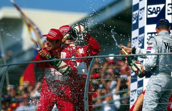 Rubens Barrichello (BRA) Ferrari, left, took an unexpected win after Michael Schumacher (GER) Ferrari, centre, tried to orchestrate a dead heat but failed. David Coulthard (GBR) McLaren, right, finished third.United States Grand Prix, Indianapolis Motor Speedway, USA, 29 September 2002.BEST IMAGE.