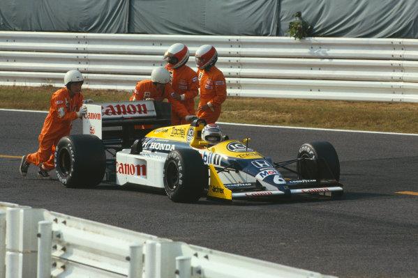 1987 Japanese Grand Prix  Suzuka, Japan. 29/10-1/11 1987.  Despite retiring from the race Nelson Piquet (Williams FW11 Honda) clinches the World Championship.  Ref: 87JAP01. World Copyright - LAT Photographic