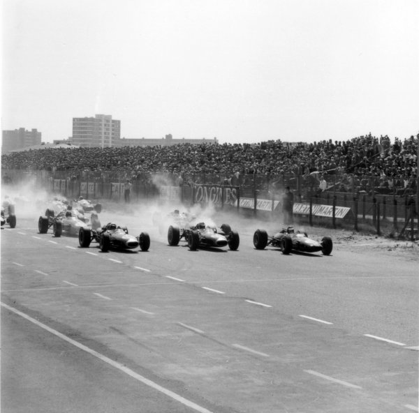 1966 Dutch Grand Prix.Zandvoort, Holland. 24 July 1966.Jack Brabham, Brabham BT19-Repco, 1st position, Denny Hulme, Brabham BT20-Repco, retired, and Jim Clark, Lotus 33-Climax, 3rd position, lead at the start, action.World Copyright: LAT PhotographicRef: 35877