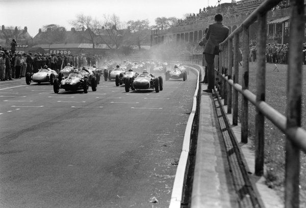 Aintree, England. 30th April 1960.Stirling Moss (Porsche 718), 1st position, leads Jack Brabham  (Cooper T45-Climax), retired, at the start of the race, action.World Copyright: LAT PhotographicRef:  8598B - 30A.