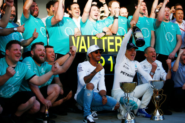 Sochi Autodrom, Sochi, Russia. Sunday 30 April 2017. Lewis Hamilton, Mercedes AMG, Valtteri Bottas, Mercedes AMG, 1st Position, Tony Ross, Race Engineer, Mercedes AMG, and the Mercedes team celebrate victory. World Copyright: Andy Hone/LAT Images ref: Digital Image _ONZ2539