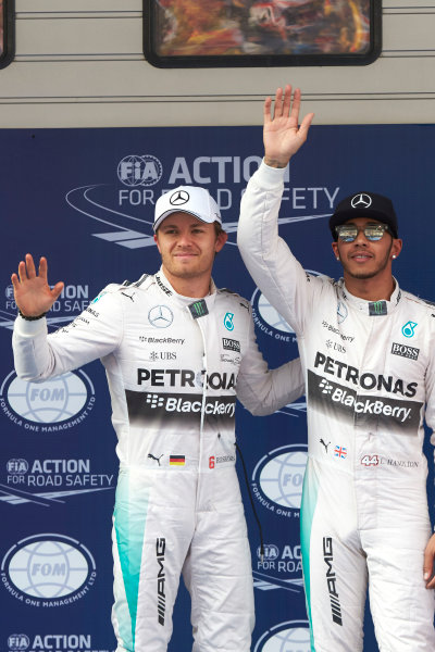 Shanghai International Circuit, Shanghai, China. Saturday 11 April 2015. Front row starters Lewis Hamilton, Mercedes AMG, and Nico Rosberg, Mercedes AMG. World Copyright: Steve Etherington/LAT Photographic. ref: Digital Image SNE10506