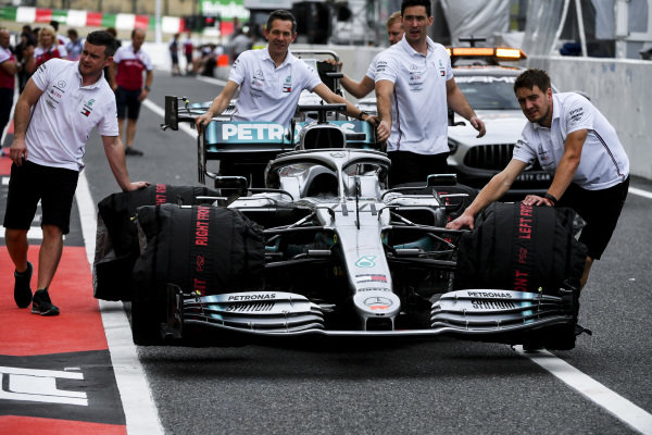 Car of Lewis Hamilton, Mercedes AMG F1 W10 being bused down the pit lane by mechanics
