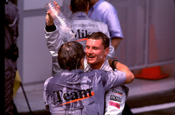 2000 French Grand Prix.Magny-Cours, France. 30/6-2/7 2000.David Coulthard (McLaren Mercedes) celebrates his 1st position with Mercedes Motorsport Director Norbert Haug.World Copyright - LAT PhotographicFormat: 35mm transparency