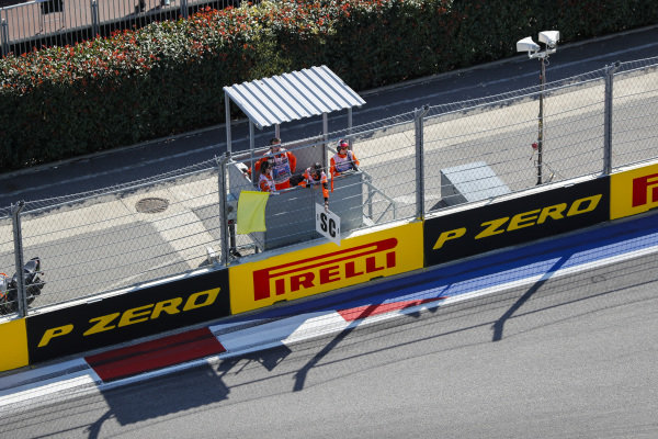 The safety-car board and yellow flag is shown